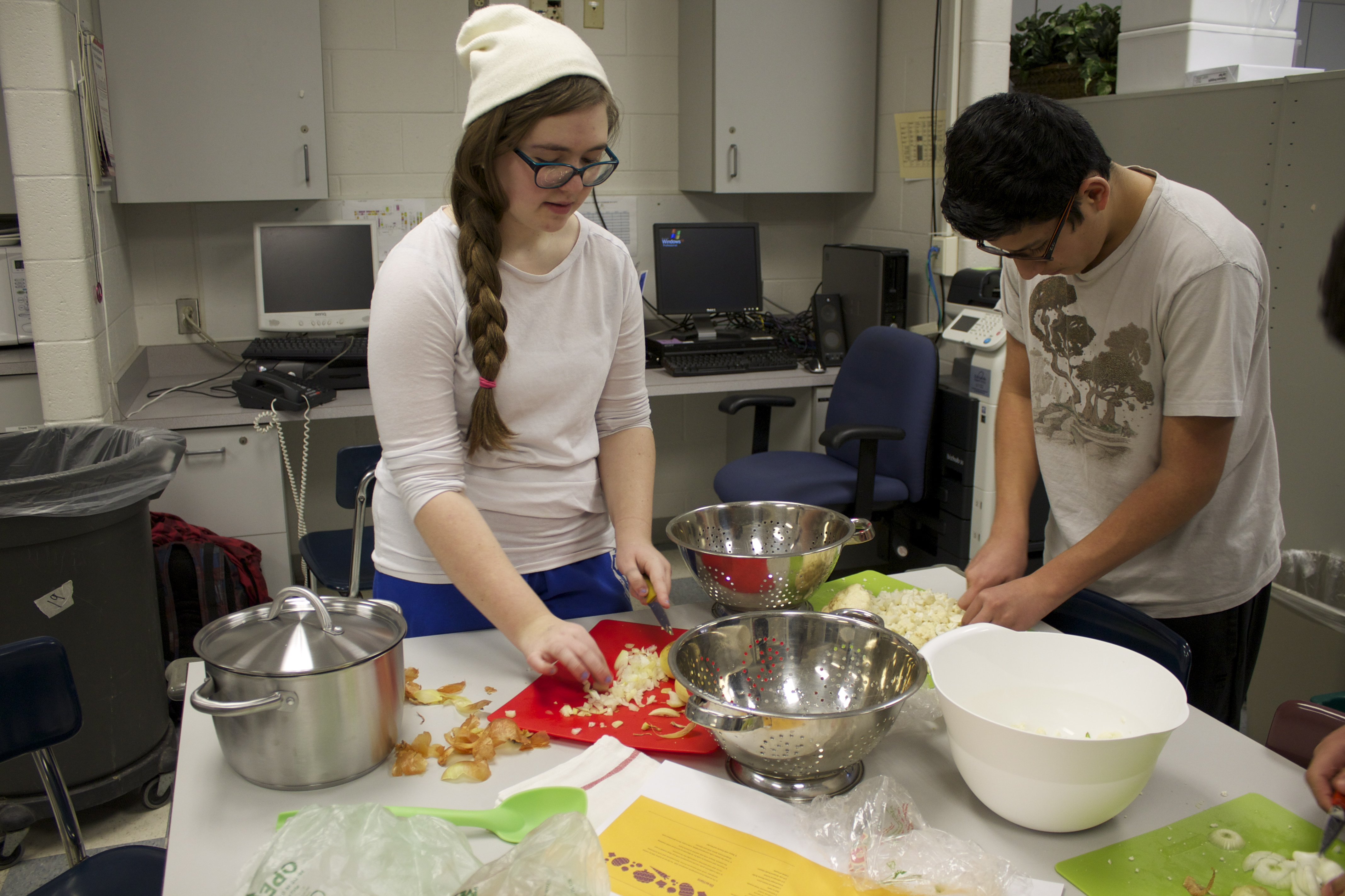 Two students cooking at Plymouth Meeting High.
